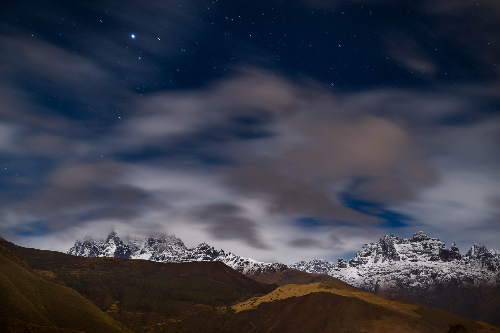 Stars Clouds Skies and Snow Over the Sacred Valley